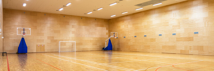Interior of empty modern basketball or soccer indoor sport court