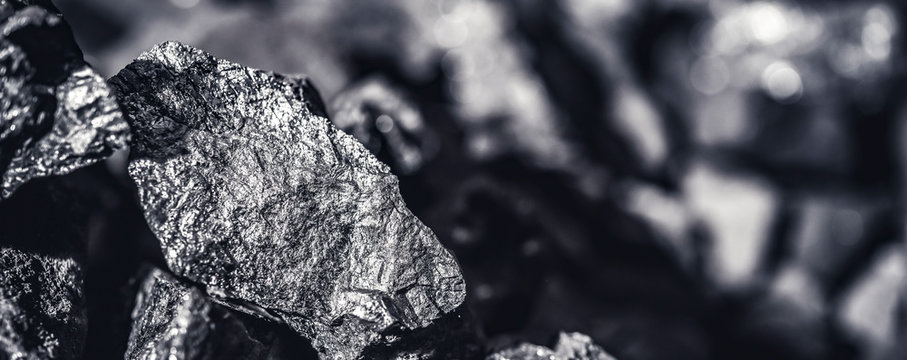 Coal miner in the man hands of coal background. Coal mining