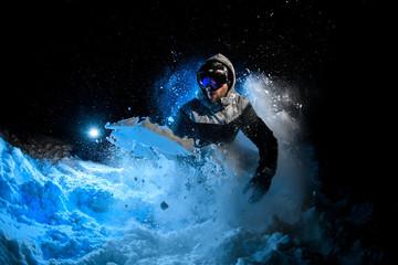 Man freerider doing stunts on blue light background