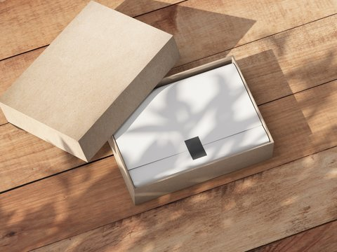 Opened carton Gift Box Mockup with white wrapping paper on the wooden table outdoor