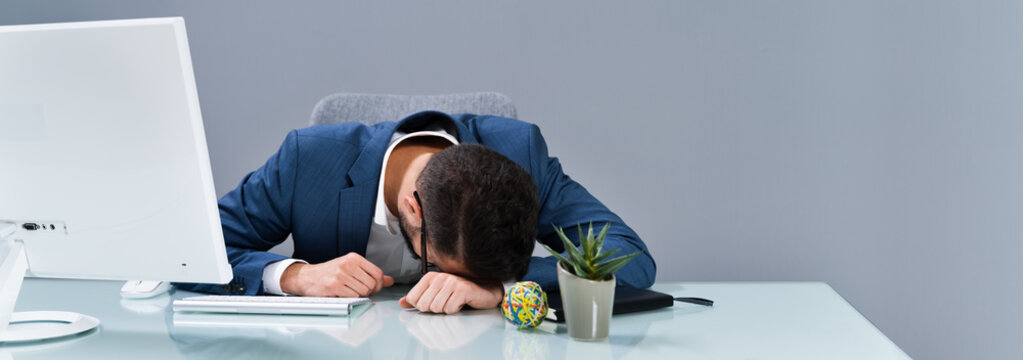 Tired Businessman Sleeping In Office