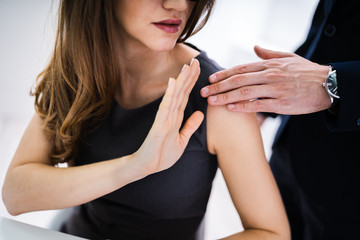 Obraz Woman Defending Herself From Sexual Harassment By Boss - fototapety do salonu