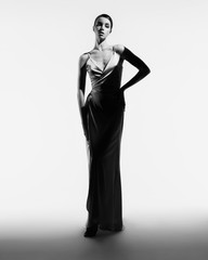 Spoed Fotobehang womenART Beautiful woman pose in studio in classic dress