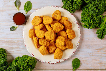 Chicken nuggets with ketchup on wooden table. Wall mural