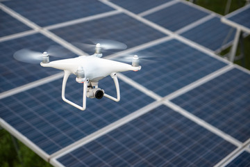 Drones and solar cells, The drone is a high angle camera shooting a solar cell farm. Which is clean energy Able to generate electricity Wall mural