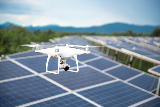 Drones and solar cells, The drone is a high angle camera shooting a solar cell farm. Which is clean energy Able to generate electricity