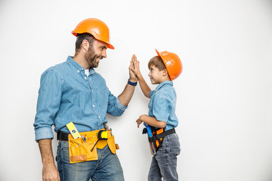 Father and son with building tools stock photo