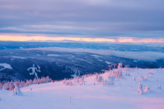 Aerial view of ski resort Hafjell in Norway with skiers going down the snowy slopes