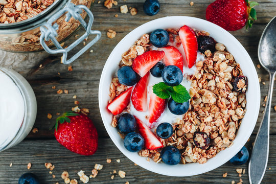 Healthy breakfast granola with fresh strawberry and blueberry.