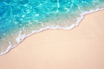 Wall Mural - Beautiful Soft blue ocean wave on fine sandy beach