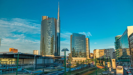 Tuinposter Milan Milan skyline with modern skyscrapers in Porta Nuova business district timelapse in Milan, Italy, at sunset.