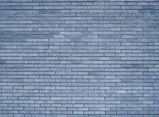 a full frame blue toned textured brick wall background