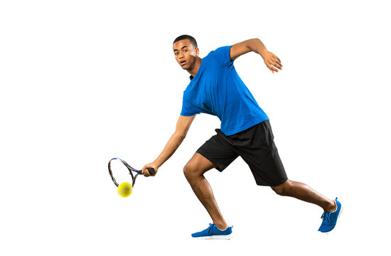 Full-length shot of African American tennis player man over isolated white background