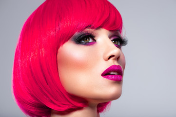 Glamour fashion model with bright make-up. Beautiful young fashion woman with pink lipstick.