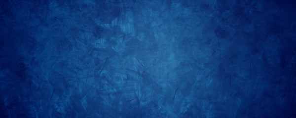 dark blue grunge cement wall background.