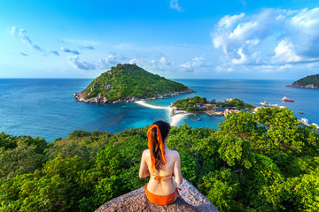 Wall Mural - Woman in bikini sitting at the viewpoint of Nang yuan island, Thailand.