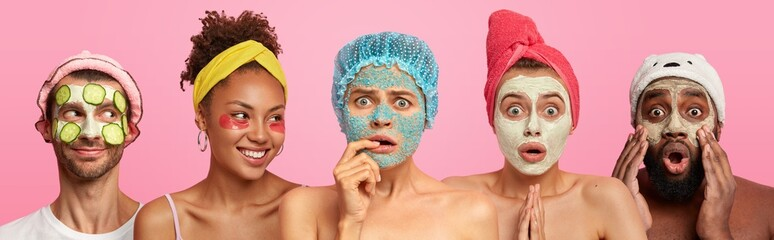 Hotizontal shot of three women with clay mask, scrub on face and patches, shocked Afro American man cares about complexion, European male applies cucumber mask, visit beauty center or beautician