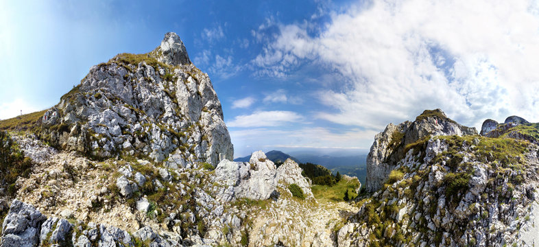 Panoramic view of Mount Piatra Mare peak at sunset on summer