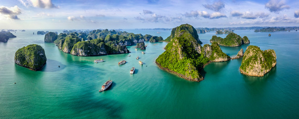 Aerial view Vung Vieng floating fishing village and rock island, Halong Bay, Vietnam, Southeast Asia. UNESCO World Heritage Site. Junk boat cruise to Ha Long Bay. Famous destination of Vietnam Wall mural