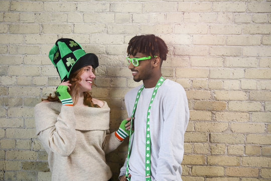 Happy Young Couple Wearing Costumes to Celebrate St. Patrick's Day.