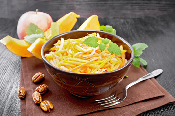 Wall Mural - Salad of pumpkin and apple in bowl on dark board