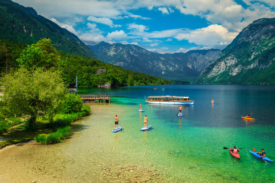 Active friends kayaking and paddling on the sup boards, Slovenia