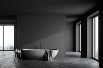 Spacious grey bathroom with stone tub