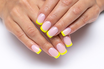 yellow french manicure, sparkles on short square nails closeup on a white background Fotobehang