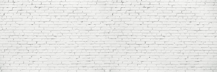 White Long Wide Wall Textured Background. Whitewashed Brick Facade Of Grungy Shabby Uneven Painted Plastered Wall. Whitened Brick Face Of Fence. Fototapete
