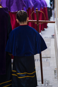 Christian Holy Week procession with Nazarenes and their hoods through the streets of the town