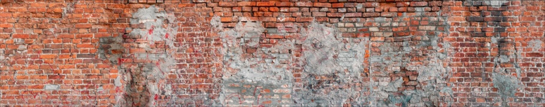 large seamless texture of a brick wall with cracks and defects