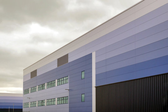modern warehouse building over cloudy sky in england uk