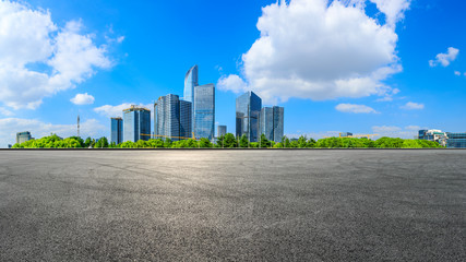 Empty race track and beautiful city skyline with buildings in Suzhou,panoramic view.