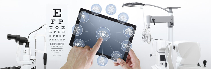 hands touch screen of digital tablet with ophthalmologist and optometrist icons symbols, ophthalmology and optometry equipment on background