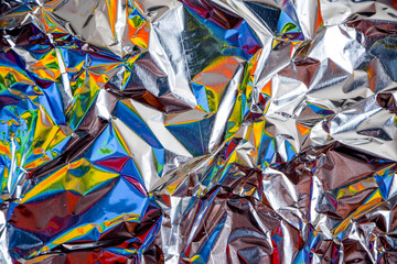 rainbow aluminium foil crumpled Silver texture abstract background