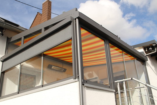 a modern new conservatory with awning