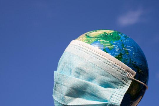 coronavirus world alert - surgical mask on globe
