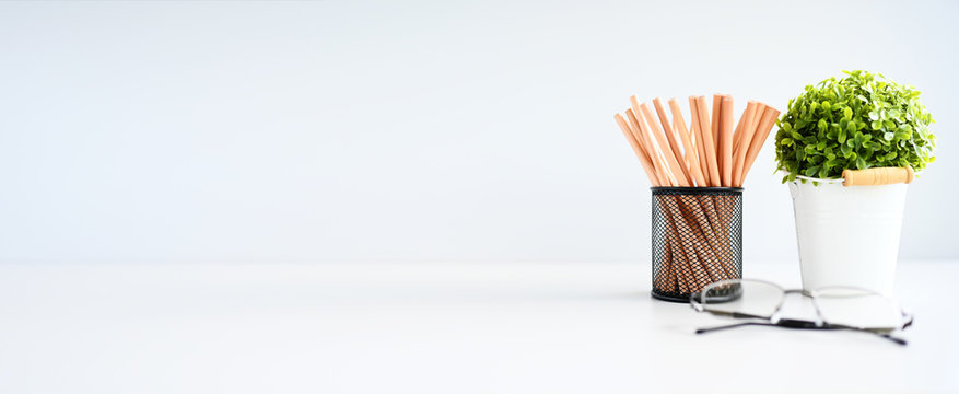 Wooden pencil and plant cactus copy space on table background