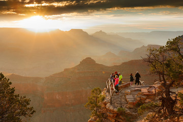 Fototapete - Sunrise at Grand Canyon. Photo Shows a Group of Tourists Watching Sunrise at Mather Point which is famous for Sunrise.
