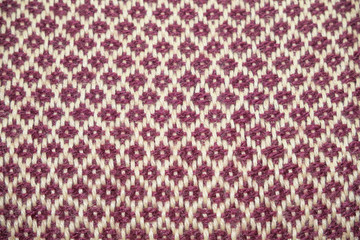 Maroon vintage scarf. Red textile with patterns with beige rhombuses.