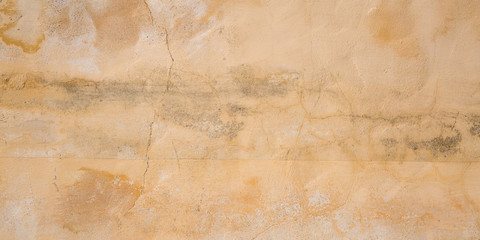 Texture of concrete wall cracks scratches beige background