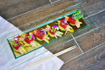 Aluminium Prints Picnic A plate of blue mango tuna sushi roll at a Japanese restaurant