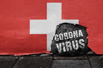 Flag of Switzerland on the wall with cracked stone with Coronavirus text on it. 2019 - 2020 Novel Coronavirus (2019-nCoV) concept, for an outbreak occurs in the Swiss Confederation.