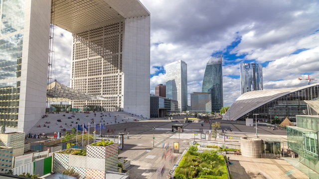 The Grande Arche and skyscrapers timelapse  in the Defence business district of Paris, France.