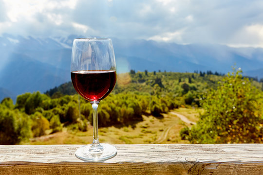 glass of wine in mountains