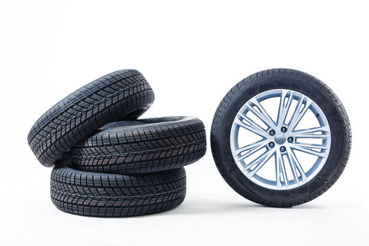 four black tires isolated on white background