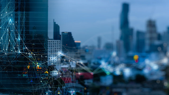 Wireless network and Connection technology concept with Abstract buildings and city background