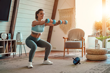Photo on textile frame Fitness Woman doing exercises at home.