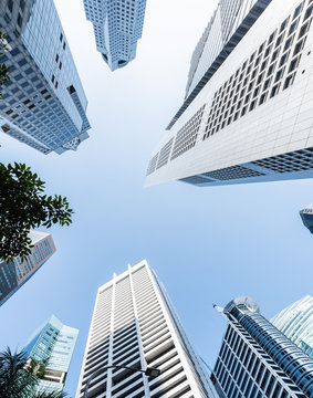 Modern business skyscrapers, high-rise buildings, architecture raising to the sky, sun. Concepts of financial, economics, future etc.