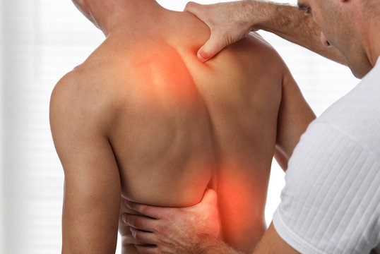 Acupressure, back pain relief concept. Male patient Physiotherapy, Injury Rehabilitation treatment
